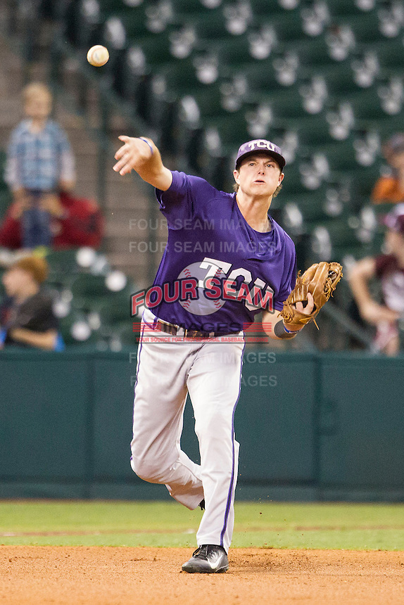 TCU Horned Frogs third baseman Derek O'Dell #5 makes a throw to first base during the NCAA baseball game against the Rice Owls on March 1, 2014 during the Houston College Classic at Minute Maid Park in Houston, Texas. Rice defeated TCU 1-0. (Andrew Woolley/Four Seam Images)