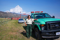 Sue Carlson, Patrol 57, San Jacinto Ranger District, escorts photographer on the Garner Ranch during the Mountain Center fire