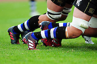 A general view of Bath Rugby coloured socks at a scrum. Pre-season friendly match, between the Scarlets and Bath Rugby on August 20, 2016 at Eirias Park in Colwyn Bay, Wales. Photo by: Patrick Khachfe / Onside Images