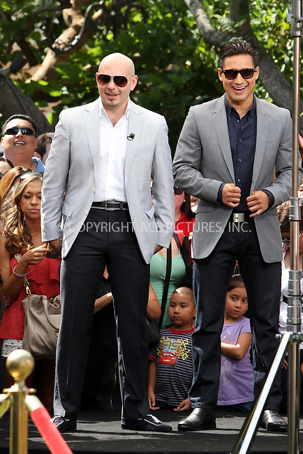 WWW.ACEPIXS.COM . . . . .  ....May 11 2012, LA....Rapper Pitbull and host Mario Lopez at a taping of Extra at The Grove on May 11 2012 in LA....Please byline: Zelig Shaul - ACE PICTURES.... *** ***..Ace Pictures, Inc:  ..Philip Vaughan (212) 243-8787 or (646) 769 0430..e-mail: info@acepixs.com..web: http://www.acepixs.com