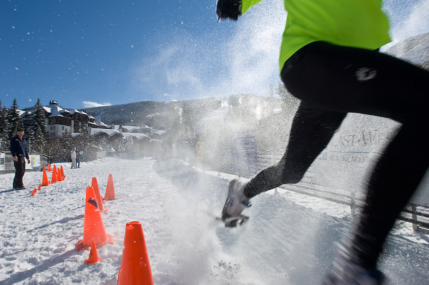 Racer John O'Neill, 17, sprints across the finish in a dead heat with friend Shea Phelan at the end of a snowshoe race at Beaver Creek, Colo., Sunday, Dec. 16, 2007. Racers competed in five-kilometer and 10-kilometer races through the slopes of the ski resort as part of the Beaver Creek Snowshoe Adventure Series.(Kevin Moloney for the New York Times)