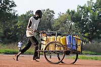 SOUTH SUDAN  Bahr al Ghazal region , Lakes State, town Rumbek, water transport with cart / SUED-SUDAN  Bahr el Ghazal region , Lakes State, Rumbek, Wasser Transport