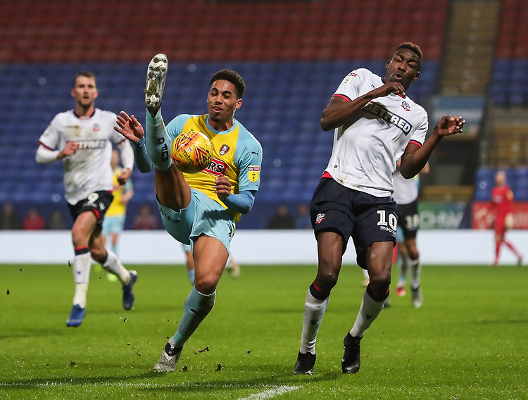 Bolton Wanderers' Sammy Ameobi competing with Rotherham United's Zak Vyner<br /> <br /> Photographer Andrew Kearns/CameraSport<br /> <br /> The EFL Sky Bet Championship - Bolton Wanderers v Rotherham United - Wednesday 26th December 2018 - University of Bolton Stadium - Bolton<br /> <br /> World Copyright © 2018 CameraSport. All rights reserved. 43 Linden Ave. Countesthorpe. Leicester. England. LE8 5PG - Tel: +44 (0) 116 277 4147 - admin@camerasport.com - www.camerasport.com
