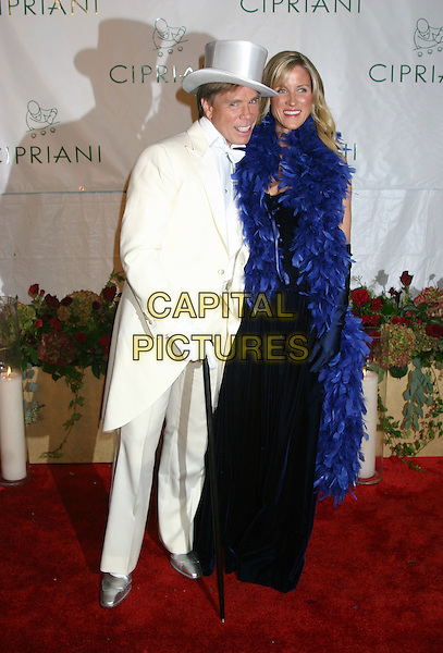 TOMMY HILFIGER.Royal Birthday Ball for Sean P. Diddy Combs - Inside Arrivals.Cipriani's, New York City, New York .November 4, 2004.full length, white suit, top hat, feather boa, gloves, cane, walking stick.www.capitalpictures.com.sales@capitalpictures.com.© Capital Pictures.com
