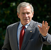 Washington, D.C. - October 1, 2006 -- United States President  George W.  Bush waves to photographers at the White House upon his return from a stay at Camp David, Sunday, October 1, 2006, in Washington, DC.  <br /> Credit: Chris Greenberg - Pool via CNP