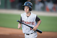 Kannapolis Intimidators batboy Allan Westerholt retrieves a bat during the game against the Hickory Crawdads at CMC-Northeast Stadium on May 21, 2015 in Kannapolis, North Carolina.  The Intimidators defeated the Crawdads 2-0 in game two of a double-header.  (Brian Westerholt/Four Seam Images)