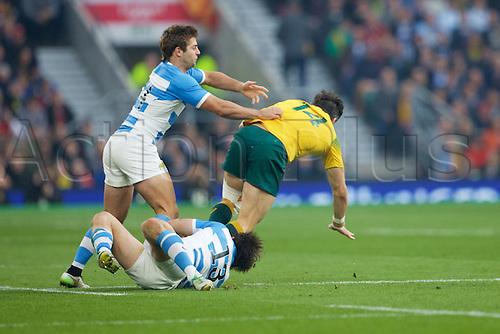 25.10.2015. Twickenham Stadium, London, England. Rugby World Cup Semi Final. Argentina versus Australia. Australia wing Adam Ashley-Cooper is tackled by Argentina centre Marcelo Bosch and Argentina wing Santiago Cordero.