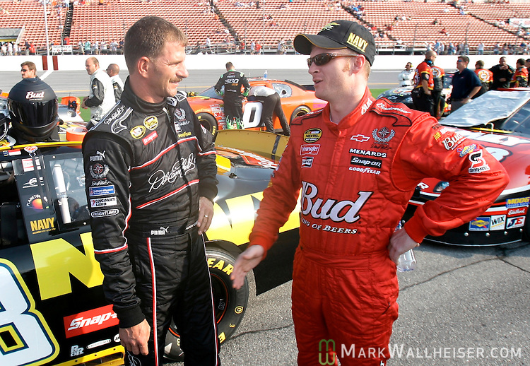 Half-brothers Kerry Earnhardt and Dale Earnhardt Jr. speak on pit road before the rain-delayed running of the Winn Dixie 250 NASCAR Busch Series race at the Daytona International Speedway in Daytona Beach, Florida July 7, 2007. Both drivers are sons of racing legend Dale Earnhardt.       (Mark Wallheiser/TallahasseeStock.com)