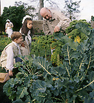 Children representing William and Dorothy being shown the vegetables in the garden by a servant at Wordsworth House.M.R.