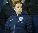 England's Gareth Southgate takes his seat in the stand.