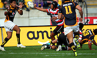 Ahsee Tuala intercepts Alapati Leiua's pass to Julian Savea to steal a runaway try. ITM Cup - Wellington Lions v Counties-Manukau Steelers at Westpac Stadium, Wellington, New Zealand on Sunday, 8 August 2010. Photo: Dave Lintott/lintottphoto.co.nz.