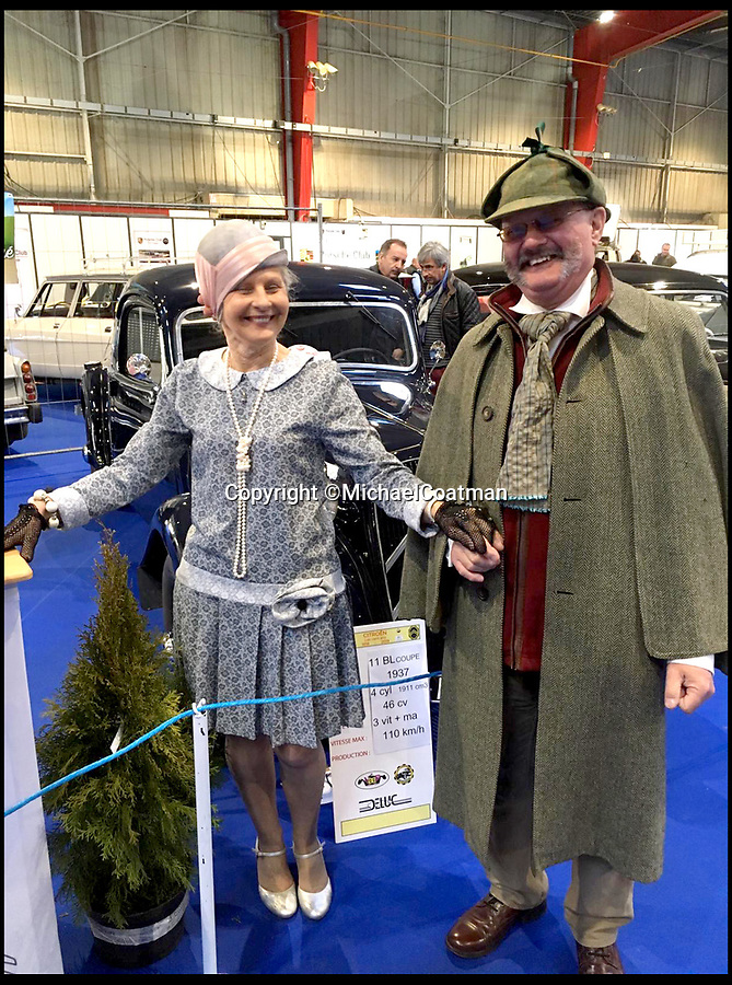 BNPS.co.uk (01202 558833)<br /> Pic:  MichaelCoatman/BNPS<br /> <br /> Michael Coatman (dressed as Sherlock) at the car show in France.<br /> <br /> A classic car enthusiast got the shock of his life when he found an illegal immigrant asleep inside his vintage motor when he arrived back in the UK.<br /> <br /> Michael Coatman, 64, was driving his vintage 1926 Vauxhall 14/40 open tourer back from a car show in Perigueux, France, when he was targeted by immigrants twice in a matter of hours.<br /> <br /> The semi-retired car salesman from Poole, Dorset, who was transporting the vintage car on a low-loader, discovered the first stow-away at a petrol station just before boarding the ferry in Caen.<br /> <br /> Despite Mr Coatman's vehicle being thoroughly searched at the port in Caen, when he got off in Portsmouth another search revealed a Somalian immigrant asleep in the front seat of his classic Vauxhall.
