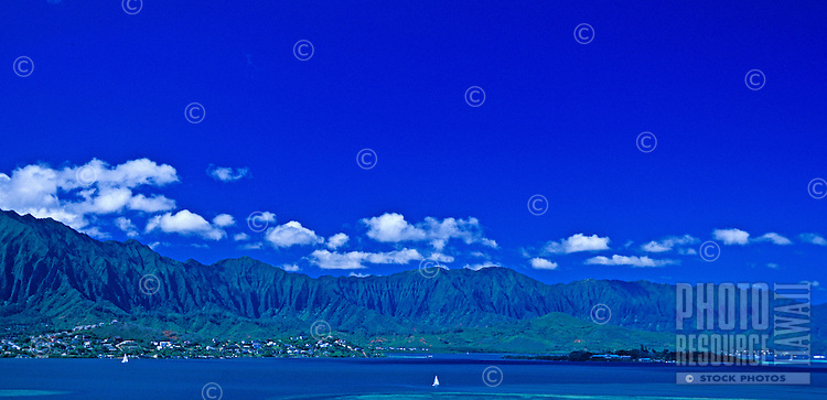This wide angle view captures the beauty of Kaneohe Bay with it's calm blue waters and coral reefs.  Located on Oahu's windward side. Ko'olau mountains in the background.