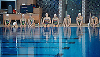 Russia Synchronized Swimming Olympic Team 2012..A few moment of rest before repeating the Team routine. Not a single voice is raised to  break the unbelievable sense of concentration looming over the whole pool...Russian synchronized Swimming Olympic Team: indisputably the strongest in the World..The team is composed by: ISCHENKO Natalia;DAVYDOVA Anastasia;KHASYANOVA Elvira;GROMOVA Maria;ROMASHINA Svetlana;KOROBOVA Daria;PATSKEVICH Alexandra;SHISHKINA Alla;TIMANINA Angelica;KOLESNICHENKO Svetlana;ZUEVA Alexandra;OLHOVA Anisya..Only nine of these twelve can compete at the Olympics, due to number restriction imposed by I.O.C...Russian Team palmares: ..Olympic Games: (synchro at the Olympics since 1984)..Team : Gold: 2000, 2004, 2008 ..World Championships..Team: Gold 1999,2001,2003,2005,2007,2009,2011..European Championships: ..Team:Gold; 1991,1993,1995,1997,1997,1999,2000,2002,2004,2006,2010..World Cup: ..Team: Gold 2002, 2006,..Photo G.Scala/Deepbluemedia.eu..