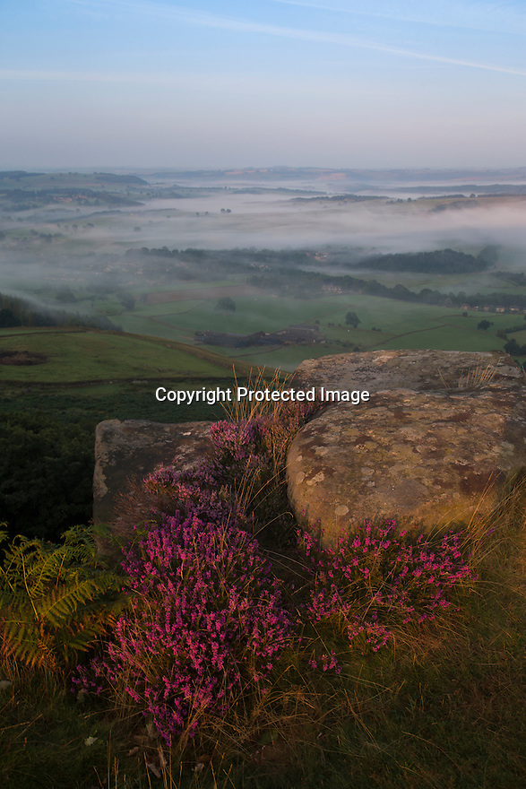 15/08/16<br /> <br /> After a chilly night in the Peak District, low cloud blankets the stunning Derbyshire countryside as the sun rises over Curbar Edge this morning ahead of a forecast week of late summer hot weather.<br /> <br /> This type of weather phenomena is known as an inversion and can occur when, for example, a warmer, less-dense air mass moves over a cooler, denser air mass. This type of inversion occurs in the vicinity of warm fronts.<br /> <br /> All Rights Reserved, F Stop Press Ltd. +44 (0)1773 550665