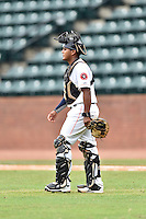 Greeneville Astros catcher Ruben Castro (4) walks to the mound during a game against the Kingsport Mets at Pioneer Park on July 3, 2016 in Greeneville, Tennessee. The Mets defeated the Astros 11-0. (Tony Farlow/Four Seam Images)
