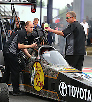Apr 24, 2015; Baytown, TX, USA; Crew chief Brian Husen (right) with NHRA top fuel driver Shawn Langdon during qualifying for the Spring Nationals at Royal Purple Raceway. Mandatory Credit: Mark J. Rebilas-