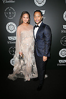 SANTA MONICA, CA - JANUARY 6: Chrissy Teigen and John Legend at Art of Elysium's 11th Annual HEAVEN Celebration at Barker Hangar in Santa Monica, California on January 6, 2018. <br /> CAP/MPI/FS<br /> &copy;FS/MPI/Capital Pictures