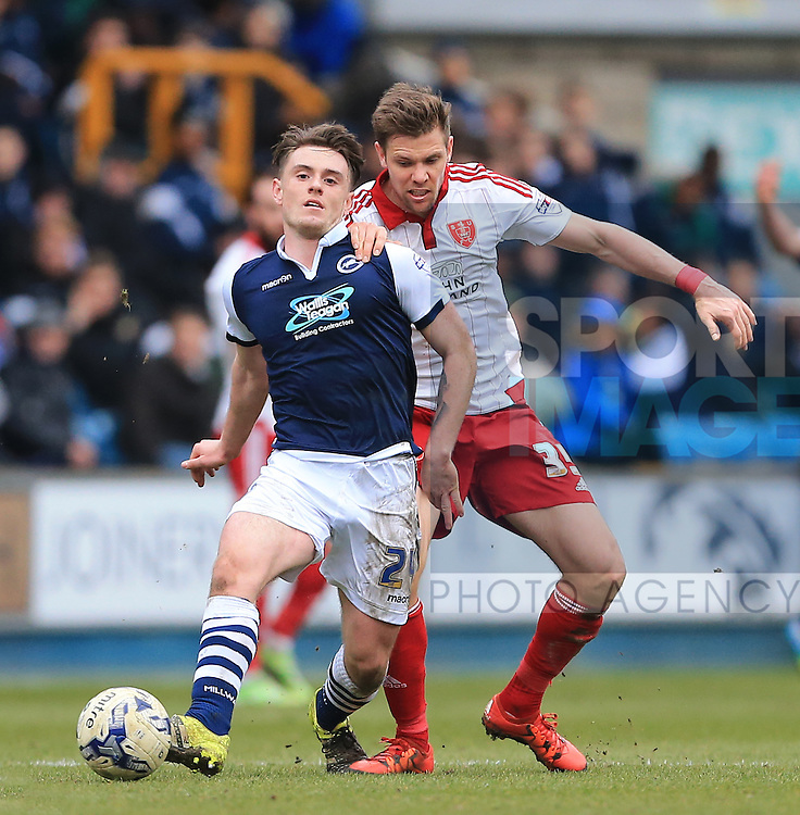 Millwall's Ben Thompson tussles with Sheffield United's Dean Hammond during the League One match at The Den.  Photo credit should read: David Klein/Sportimage