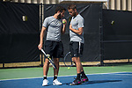 Petros Chrysochos (left) of the Wake Forest Demon Deacons talks to his doubles partner Bar Botzer during the match against the Florida Gators at the Wake Forest Tennis Center on March 30, 2018 in Winston-Salem, North Carolina.  The Gators defeated the Demon Deacons 4-3.  (Brian Westerholt/Sports On Film)
