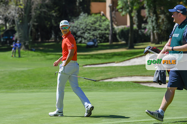 HaoTong Li (CHN) reacts to draining his long eagle putt from the fringe on 1 during round 1 of the World Golf Championships, Mexico, Club De Golf Chapultepec, Mexico City, Mexico. 2/21/2019.<br /> Picture: Golffile | Ken Murray<br /> <br /> <br /> All photo usage must carry mandatory copyright credit (© Golffile | Ken Murray)