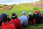 The USA TEam sits on the 18th and watches the last match in the Session 3 Foursomes and Fourball Matches during Day 3 of the The 2010 Ryder Cup at the Celtic Manor, Newport, Wales, 3rd October 2010..(Picture Eoin Clarke/www.golffile.ie)