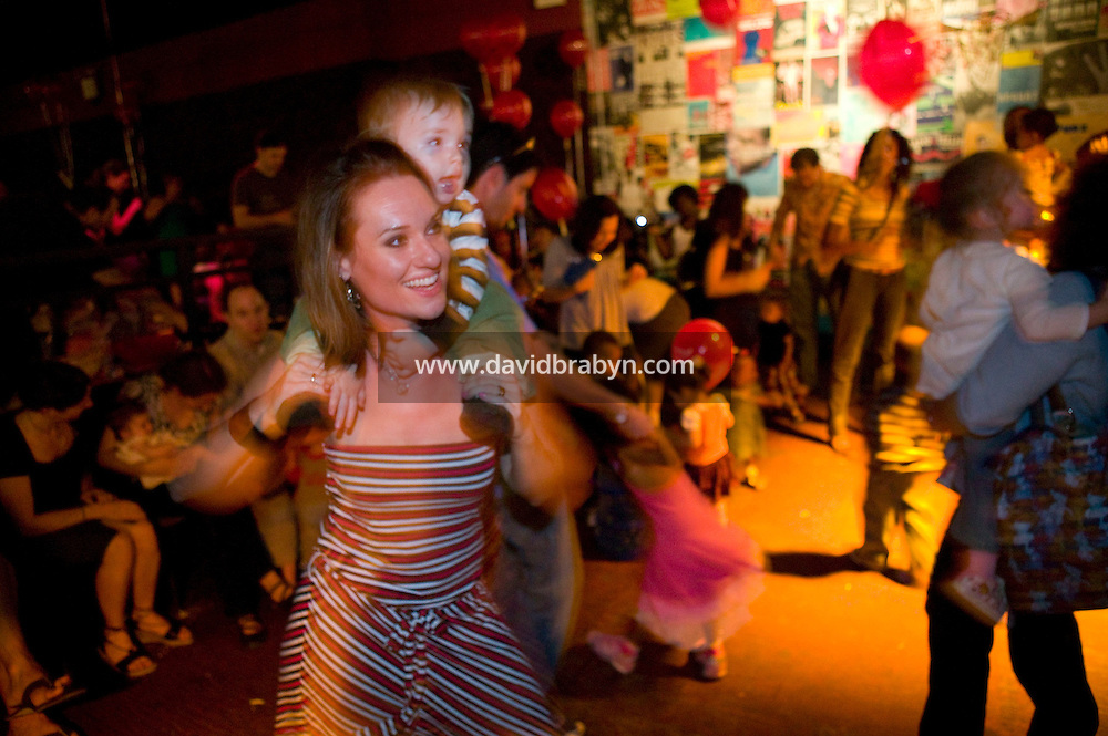 14 month-old Wilson and mum (L) attend a Baby Loves Disco event at Southpaw nightclub in the Park Slope neighborhood of Brooklyn in New York City, USA, 6 October 2007. In two years, Baby Loves Disco, a midday soiree specifically for the Mommy-and-me set, has become a nationwide phenomenon. One afternoon each month, local organizers take over a nightclub, complete with a cash bar and DJ and throw open the doors to anyone under the age of 7, accompanied by parents.