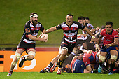 With Samuel Slade on his shoulder, Dan Hyatt makes an attacking run from a ruck. Mitre 10 Cup rugby game between Counties Manukau Steelers and Tasman Mako, played at Navigation Homes Stadium Pukekohe on Friday September 6th 2019. Tasman won the game 36 - 0 after leading 24 - 0 at halftime.<br /> Photo by Richard Spranger.