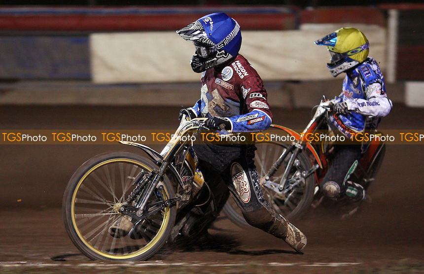 Heat 8: Kim Nilsson (blue) and Piotr Pawlicki (yellow) - Lakeside Hammers vs Poole Pirates, Elite League Speedway Play-Off Semi-Final 1st leg at the Arena Essex Raceway, Pufleet - 24/09/12 - MANDATORY CREDIT: Rob Newell/TGSPHOTO - Self billing applies where appropriate - 0845 094 6026 - contact@tgsphoto.co.uk - NO UNPAID USE.