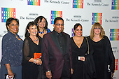 Herbie Hancock, his wife, Gigi, and their family arrive for the formal Artist's Dinner honoring the recipients of the 2013 Kennedy Center Honors hosted by United States Secretary of State John F. Kerry at the U.S. Department of State in Washington, D.C. on Saturday, December 7, 2013. The 2013 honorees are: opera singer Martina Arroyo; pianist,  keyboardist, bandleader and composer Herbie Hancock; pianist, singer and songwriter Billy Joel; actress Shirley MacLaine; and musician and songwriter Carlos Santana.<br /> Credit: Ron Sachs / CNP