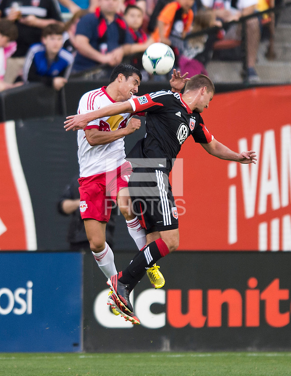 Perry Kitchen (23) of D.C. United goes up for a header with Tim Cahill (17) of New York Red Bulls during the game at RFK Stadium in Washington, DC.  New York Red Bulls defeated D.C. United, 2-0.