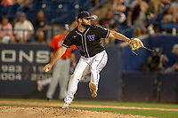 University of Washington Huskies Joe DeMers (24) follows through on his delivery against the Cal State Fullerton Titans at Goodwin Field on June 10, 2018 in Fullerton, California. The Huskies defeated the Titans 6-5. (Donn Parris/Four Seam Images)