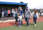 Wildcats' Brandon Lapointe takes the field with his family during Sophomore Day ceremonies at Western Nevada College in Carson City, Nev., on Saturday, April 25, 2015. <br /> Photo by Cathleen Allison