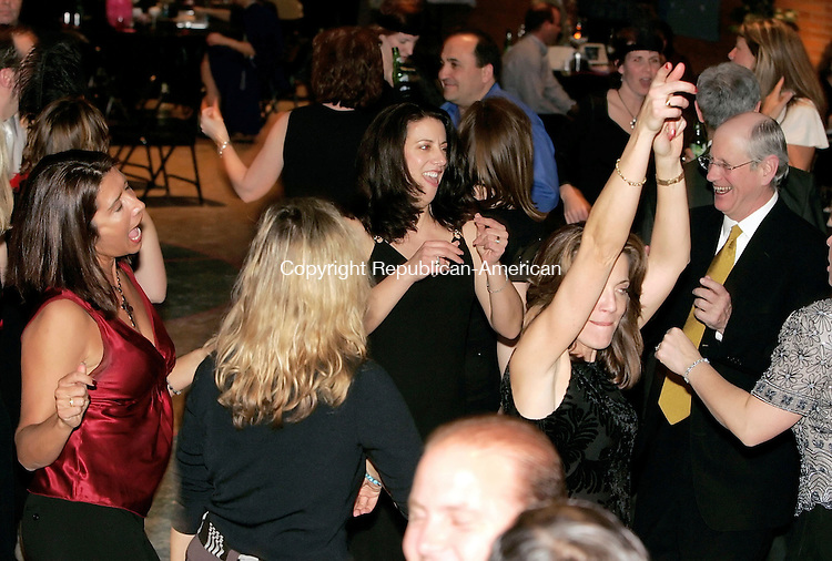 """CHESHIRE, CT  11 MARCH 2005 -031106JS04-Guests dance to music on Saturday during the St. Bridget School's """"A Roaring 20's Gala at St. Bridgets School in Cheshire. The 7th annual gala is the school's major fundraiser and proceedes from the event goes into the school's general education fund.     --- Jim Shannon Republican-American --"""