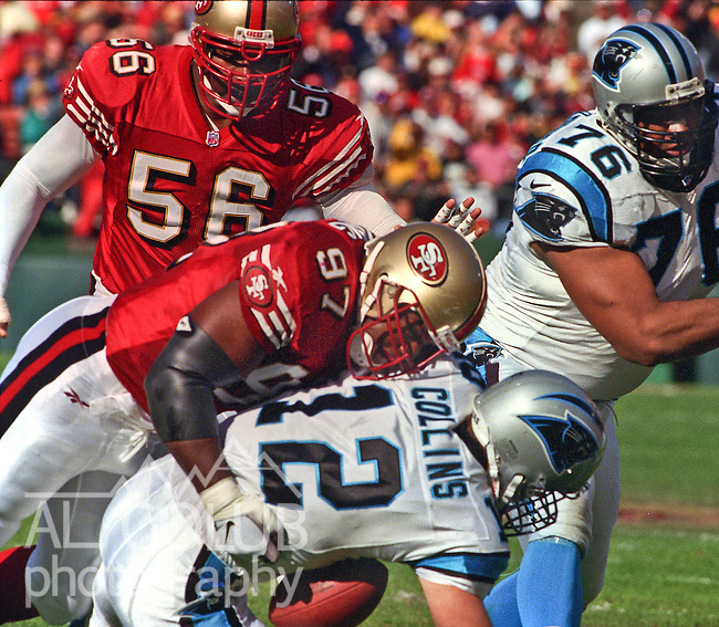 San Francisco 49ers vs. Carolina Panthers at Candlestick Park Sunday, November 16, 1997.  49ers beat Panthers  27-19.  San Francisco 49ers defensive tackle Bryant Young (97) sacks Carolina Panthers quarterback Kerry Collins (12).