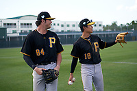 Pittsburgh Pirates Conner Uselton (84) and Ji-Hwan Bae (18) during a minor league Spring Training game against the Philadelphia Phillies on March 13, 2019 at Pirate City in Bradenton, Florida.  (Mike Janes/Four Seam Images)