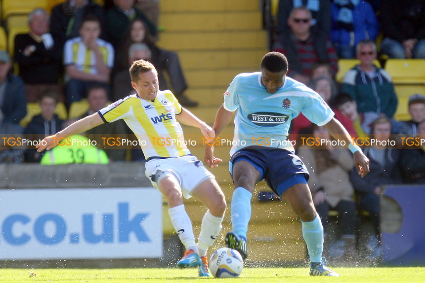 Lee Mansell of Torquay United and Ian Gayle of Dagenham and Redbridge - Torquay United vs Dagenham and Redbridge, Sky Bet League Two Football at the Plainmoor Stadium - 18/04/14 - MANDATORY CREDIT: Dave Simpson/TGSPHOTO - Self billing applies where appropriate - 0845 094 6026 - contact@tgsphoto.co.uk - NO UNPAID USE