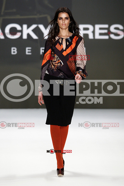 A model walks the runway at the BLACKY DRESS FASHION SHOW during the Mercedes-Benz Fashion Week autumn/winter 2012 Berlin at Brandenburger Gate in Berlin, Germany, 20.01.2012...Credit: Poslada/face to face /MediaPunch Inc.