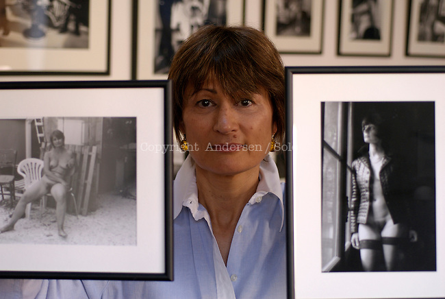 Catherine Millet at home with pictures of her taken by Jacques Henric