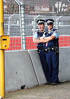 Police watch from Holden Hairpin during Race Two during Day Three of the Hamilton 400 Aussie V8 Supercars Round Two at Frankton, Hamilton, New Zealand on Sunday, 19 April 2009. Photo: Dave Lintott / lintottphoto.co.nz