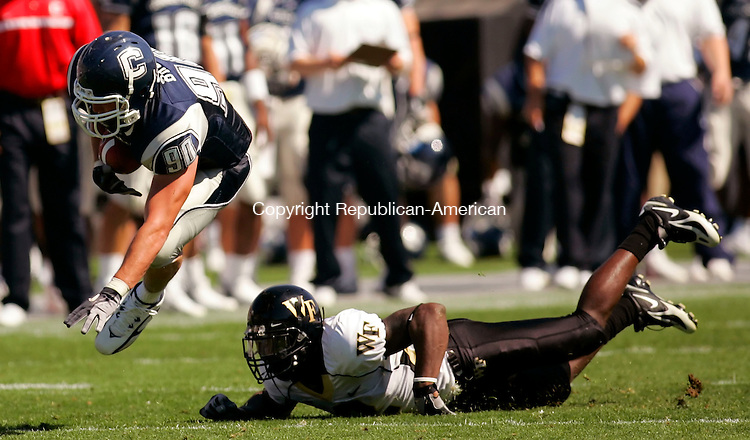 EAST HARTFORD, CT--16 SEPTEMBER 2006--091606JS02-UConn's Steve Brouse gets upended by  Wake Forest's Alphonso Smith during their game Saturday at Rentschler Field in East Hartford. The Demon Deacon's defeated the Husky's 24-14. --Jim Shannon / Republican-American--