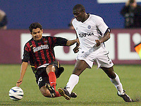 Amado Guevara of the MetroStars goes for a tackle on Zizi Roberts. The Colorado Rapids lost to the NY/NJ MetroStars 2-1 on 5/3/03 at Giant's Stadium,East Rutherford, NJ.