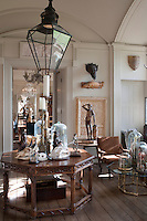 Every surface in the ante-room is home to a small collection of objects and every room is full of curios and antiques