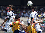 UNAM Pumas' midfielder Marco Antonio Palacios (R) heads the ball on top of Morelia Monarcas' Cristian Nasuti ( Bottom L) and Gustavo Trujillo as UNAM Pumas Joaquin Beltran (L) looks on during the soccer match in the University Stadium, March 12, 2006. UNAM Pumas defeated Morelia 1-0. Photo by Javier Rodriguez