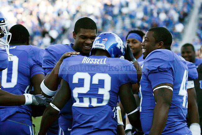 Teammates congratulate freshman running back Donad Russell after he made a touchdown on a 79 yard run making the score 37-6 in the second half of UK's win over EKU on Saturday, Nov. 7, 2009 at Commonwealth Stadium. Photo by Britney McIntosh | Staff