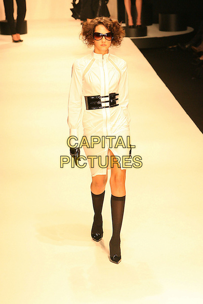 MODEL.Mercedes-Benz Fall 2006 L.A. Fashion Week - Louis Verdad - Arrivals held at Smashbox Studios, Culver City, California, USA..March 19th, 2006.Photo: Zach Lipp/AdMedia/Capital Pictures.Ref: ZL/ADM.full length catwalk black wide belt knee high socks white dress.www.capitalpictures.com.sales@capitalpictures.com.© Capital Pictures.