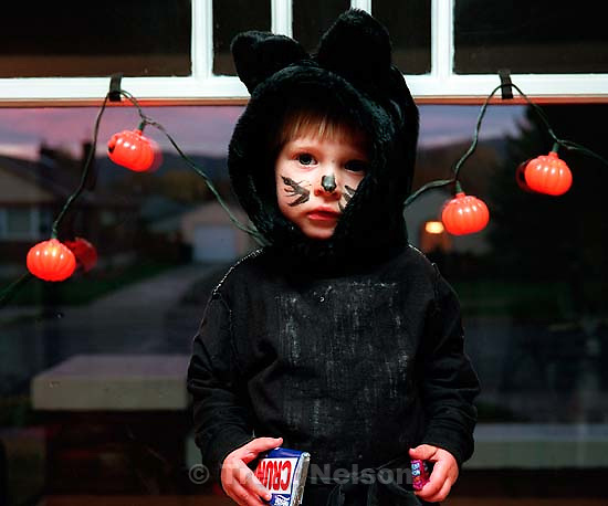 Noah Nelson in his black cat Halloween costume.<br />