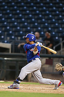 Gleyber Torres #13 of the AZL Cubs bats against the AZL Rangers at Surprise Stadium on July 6, 2014 in Surprise, Arizona. AZL Rangers defeated the AZL Cubs, 7-5. (Larry Goren/Four Seam Images)