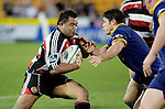 Simon Lemalu prepares for the collision with Callum Bruce. Air NZ Cup game between Counties Manukau & Otago played at Mt Smart Stadium,Auckland on the 29th of July 2006. Otago won 23 - 19.