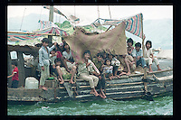 Vietnamese refugees arrive by boat in Hong Kong. Tens of thousands of Vietnamese refugees fled the Communist regime by boats to Hong Kong in 1980s.